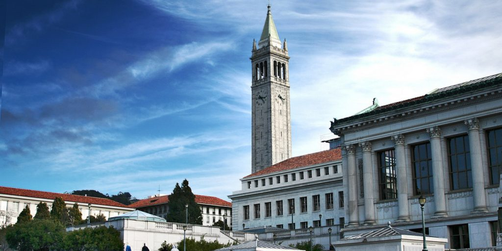 uc berkeley campus with their main tower in the center of the picture.