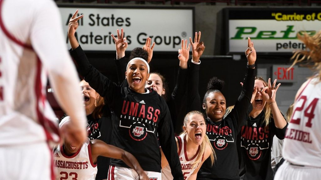 The UMass female basketball players  cheering