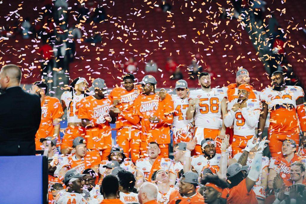 The Clemson Football Team winning