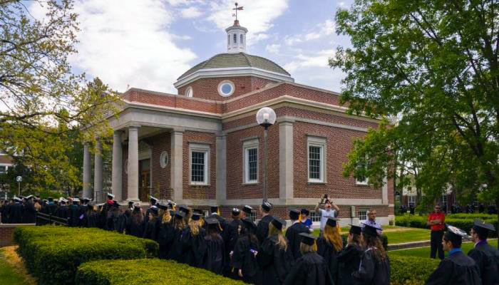 graduates lining up to go into the kirk memorial building