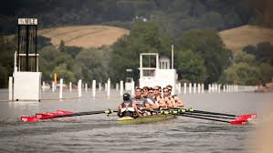 the men rowing on the water