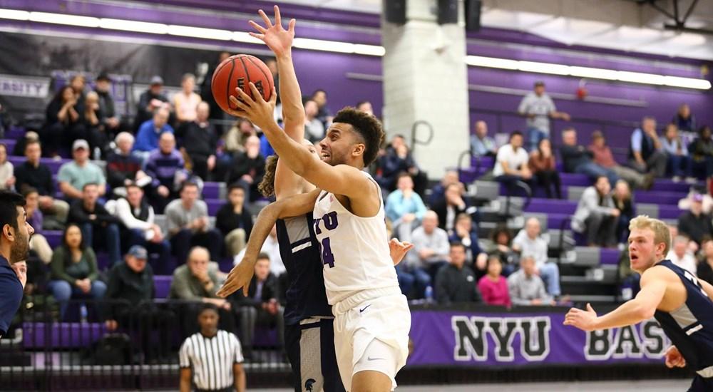 A NYU basketball player contesting for the ball
