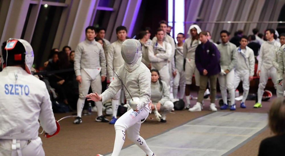 Two fencers competing against each other