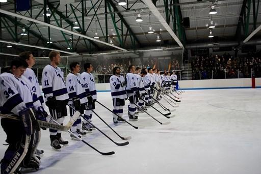 The Ice hockey team posing on the rink