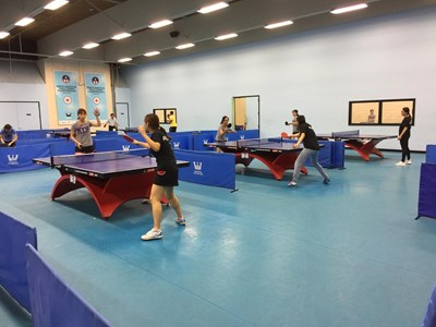 table tennis players at a practice session