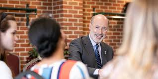 the governor of Pennsylvania with students talking about scholarship plan