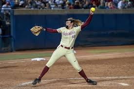 a girl getting read to pitch the ball