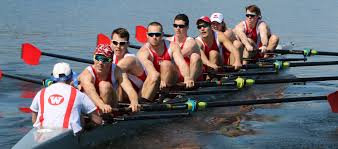 a group of rowing members on the water