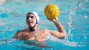 a player holding the ball in the water