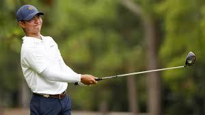a golf player swinging