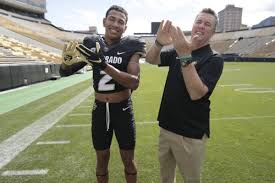 a football player and coach together