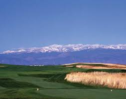 the golf course with the mountains behind