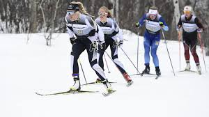 women on the snow with their skiis