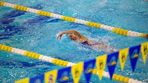 a woman swimming in a race