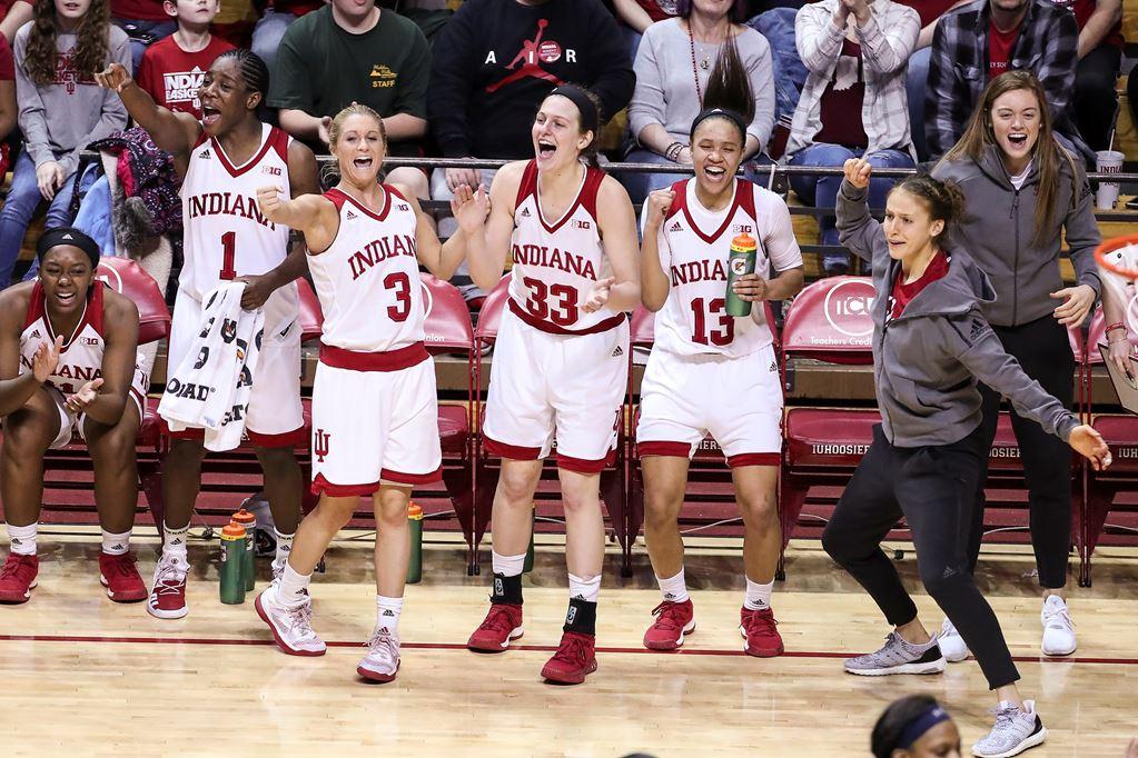 Women on the IU basketball team celebrating