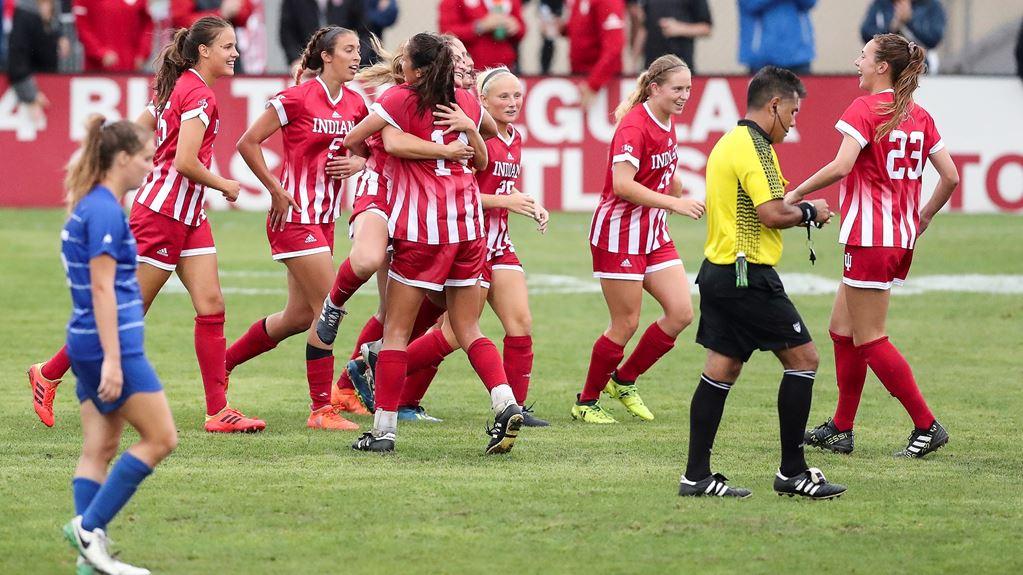 The IU women's soccer team celebrating a win