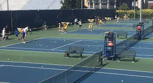 the tennis courts with students