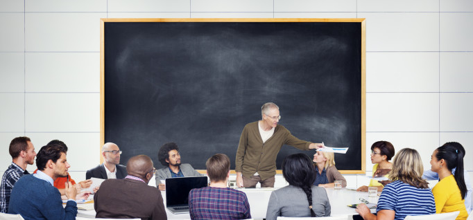 a professor teaching students