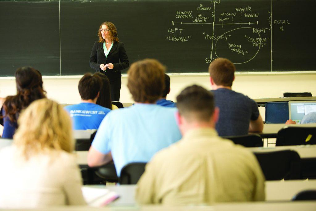Professor speaking to students.