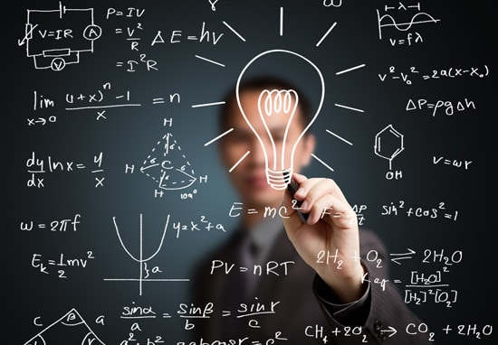 a person drawing lightbulbs, physics, math and chemistry icons on the blackboard
