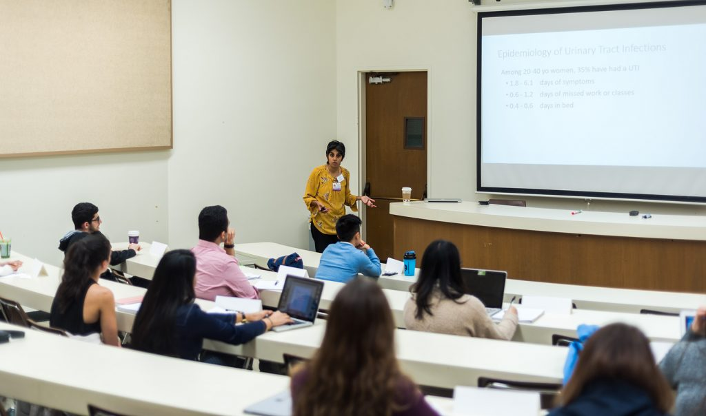 Professor teaching to students in class.