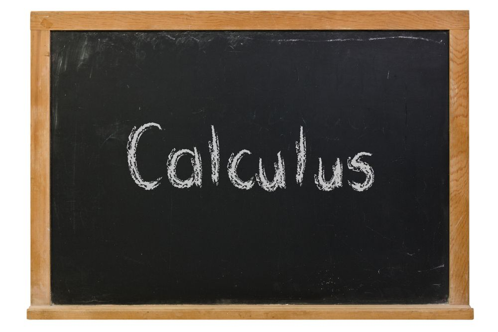 A chalkboard with the word calculus written in chalk.