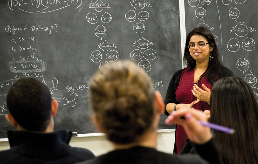 a professor at CUNY teaching algebra concepts to students
