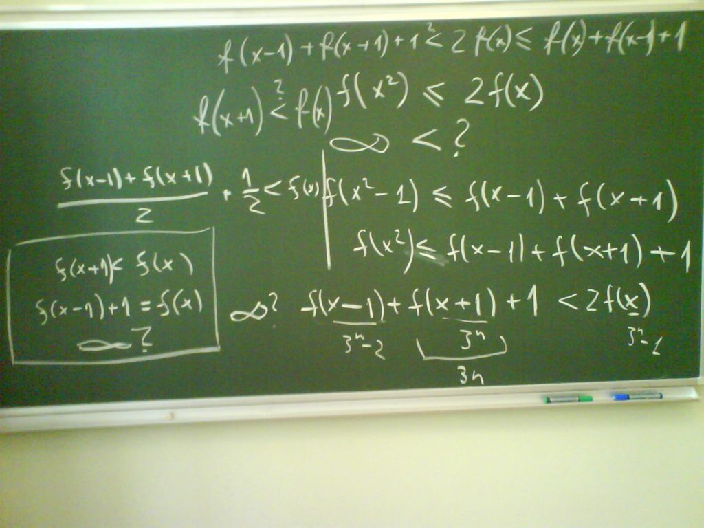 A chalkboard with math formulas written in chalk based on different methods.
