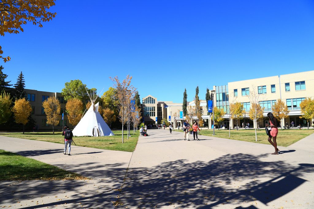Mount Royal University students walking on campus.