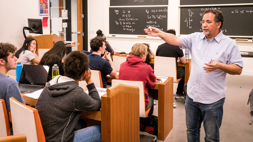 Professor teaching math to students.