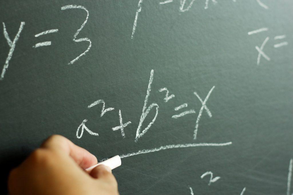 A common mathematics formula written on a chalkboard.