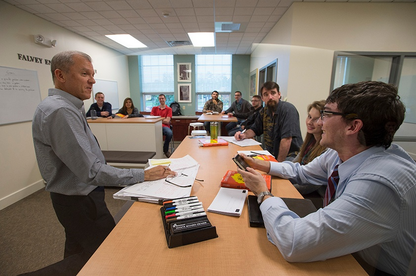 Professor working with students in class at Langara