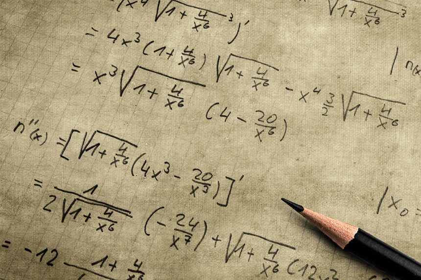 a pencil onto of a sheet with many math equations