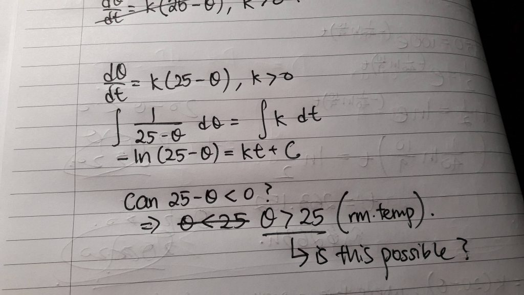 Differential Equation written in pen on notebook paper.