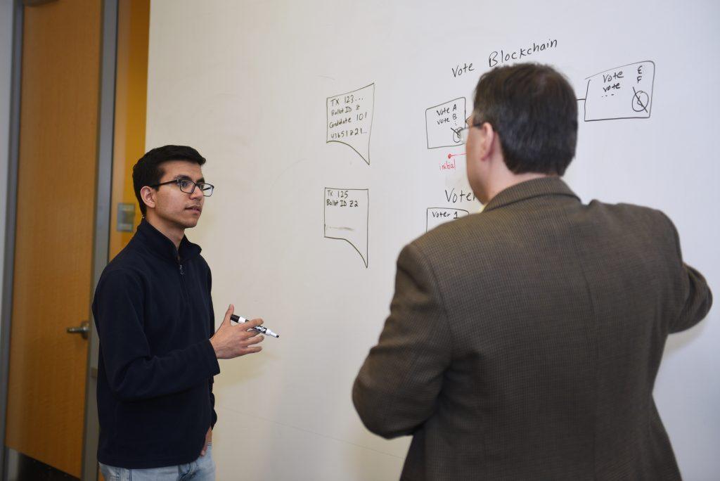 a professor teaching a student about math