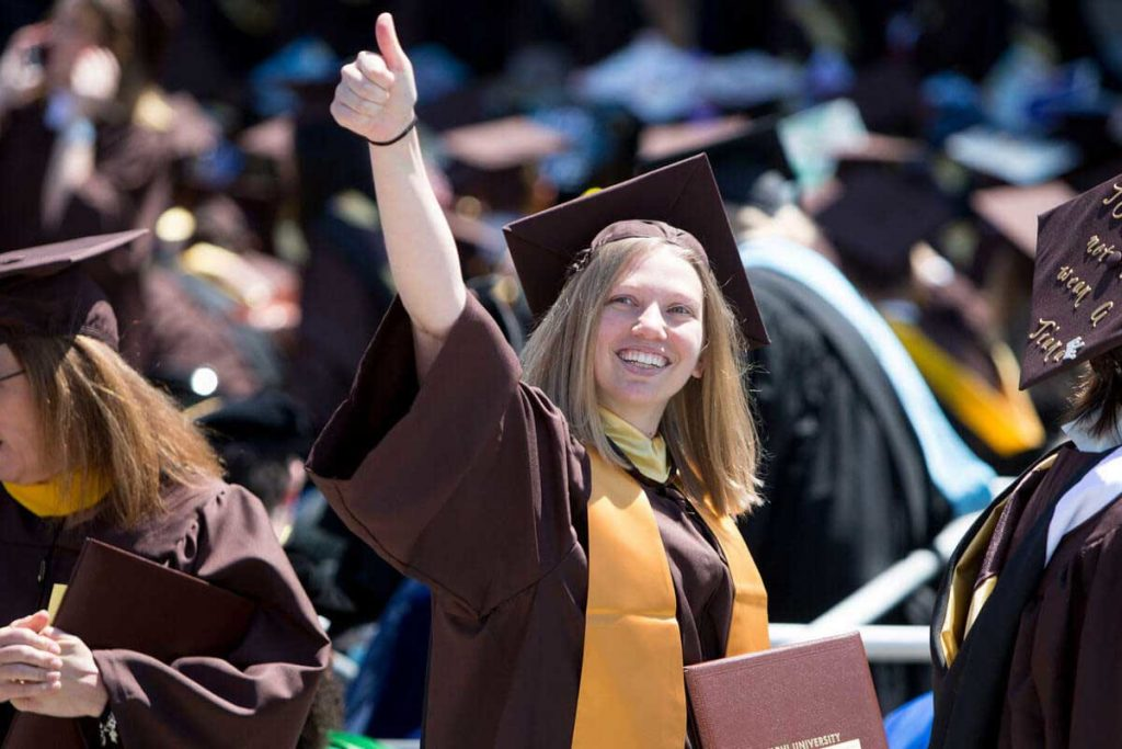 A student graduating from Adelphi