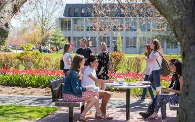 Adelphi students sitting outside