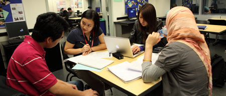 a group of students at baruch in a study group