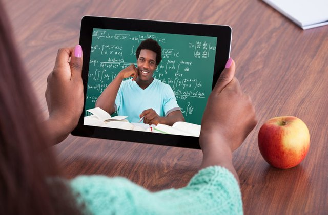Student learning online with an IPAD.