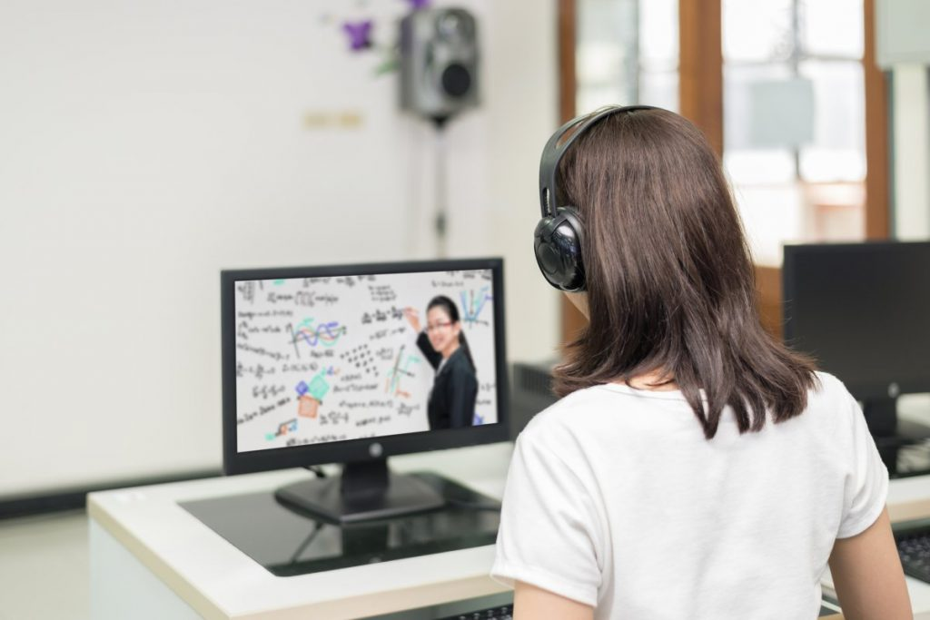 Student listening during online lecture.