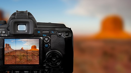 A camera taking a picture of a desert.