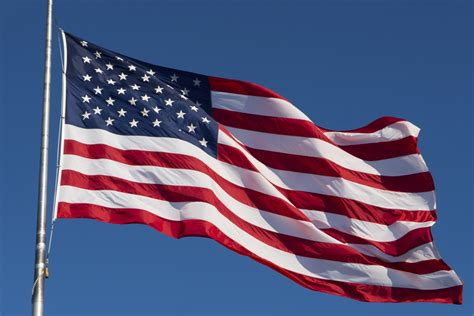 An American flag waving in the wind.