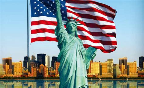The Statue of Liberty with the American Flag behind it.