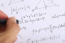 Liberty University student doing math problems on a piece of paper
